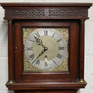 Dark oak cased week duration grandfather longcase clock, weight driven with pendulum, timepiece only. Square topped hood with blind fretwork, and brass terminal, fluted pillars. Brass dial with matt centre and silvered chapter ring, with brass spandrels and ornate blacked steel hands, signed John Preston, Beccles. Key winding hole and dummy date aperture at six o'clock. Clock case, dial plate etc. all date from approximately 1760, and the brass 'A' frame movement dates from the mid eighteen hundreds