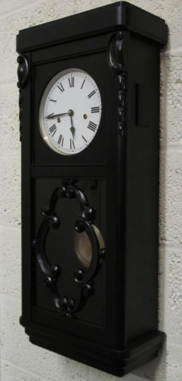 Black stained oak wood cased 8 day Westminster chime wall clock by Winterhalder and Hofmeier. Refurbished white painted dial, black roman numerals with black painted steel hands. Spring driven, pendulum movement dating from the 1920's.