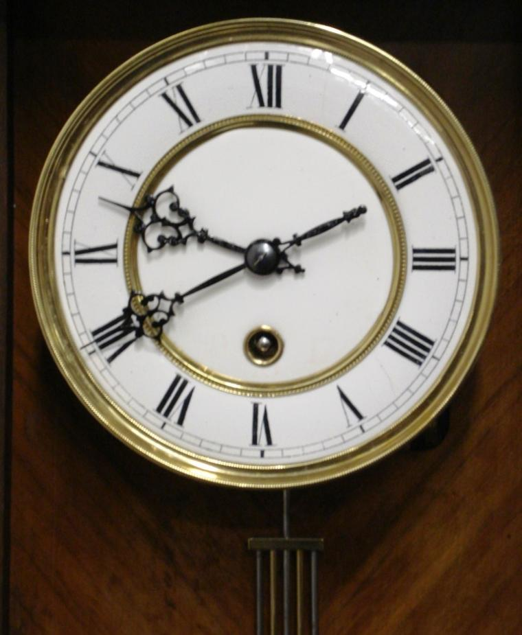 Good quality Vienna Regulator style wall clock attributed to Lenzkirch and circa 1870. Typical decorative pine and mahogany veneer casework housing an 8 day 'A' frame spring driven movement stamped TH and numbered 153392. White enamel dial with brass bezel and black roman numerals with ornate black painted steel hands.