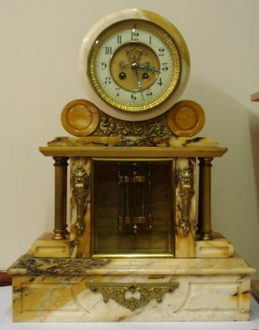 French 8 day white marble cased mantel clock with applied gilt decoration and side columns. Round clock case with gilt bezel and chamfered glass over white enamel chapter ring with matt gilt centre, black gothic hours and ornate blued steel hands. Visible Brocot escapement and slow / fast adjuster at 12 o'clock. Good quality circular brass spring driven movement, maker unknown, numbered #1339, with count wheel strike on a bell and a mercury pendulum.