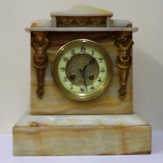 "French 8 day white marble cased mantel clock circa 1890. Architectural square case with decorative applied ormolu mouldings and gilt circular bezel with flat chamfered glass over an ivory enamel chapter ring with silvered and gilt fretwork centre. Black gothic hours and ornate blued steel hands and slow / fast adjuster at 12 o/c. Good quality pendulum regulated, spring driven, gong striking French brass drum movement with an 'AD Mougin' 'Deux Medailles' touch mark and numbered #44.  Dimensions: Height - 11.5"", width - 10.25"", depth - 6.25""."