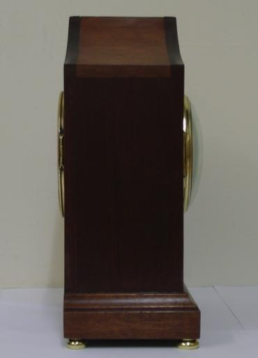 French 8 day walnut cased mantel clock striking on a gong, circa 1870. Elegant lancet topped case with extensive floral themed  marquetry inlay and  integral plinth with brass bun feet. Gilt brass bezel with convex  glass over an enamelled convex dial with black roman hours and black steel moon hands, slow / fast adjust at 12 o'clock. Ornate brass rear door with sound frets over a good quality French brass drum, spring driven pendulum regulated, movement by Vincenti. Movement and pendulum both numbered #66655 and the movement stamped with the Vincenti mark incorporating a 'Medaille d'Argent - 1855' award.