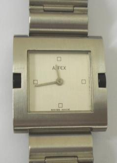 Modern quartz swiss made wrist watch by Alfex. Square brushed stainless steel case with matching integral bracelet and stainless steel back. White painted dial with quarter hour markers and silver coloured hands. Water resistant case with swiss made movement.