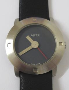Modern quartz swiss made wrist watch by Alfex. Brushed stainless steel case water resistant to 3 atmospheres with a polished stainless steel back and on an original Alfex black leather strap. Dark coloured dial with matt stainless steel coloured hands and a red sweep seconds hand.