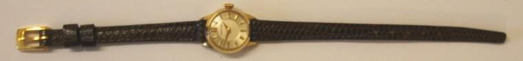 Ladies Certina wrist watch with manual wind 17 jewel Swiss made Certina 12-10 movement circa 1970, housed in 14ct gold case with brown leather strap. Silver coloured dial with gilt baton hour markers and matching hands.