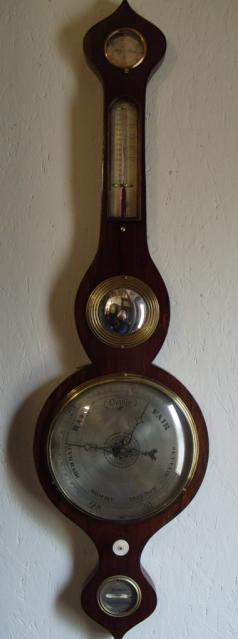 By Arnoldi of Gloucester, oak cased mercury barometer with onion style top and bottom, and silvered dials: - hygrometer, thermometer, convex mirror, barometer, an ivory hand adjuster and bubble level gauge.