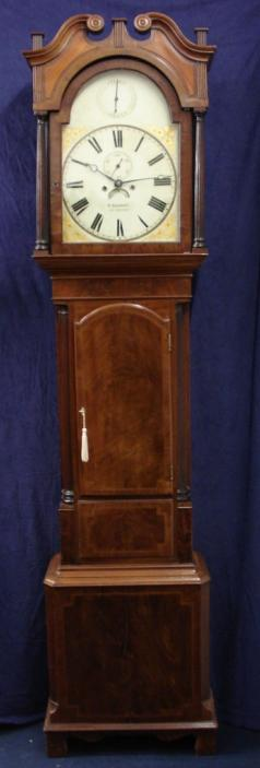 Flame mahogany and boxwood inlay cased longcase clock, with painted face and swan neck hood with fluted pillars. Bell striking, 8 day movement, with seconds indication and date display, together with 'strike / silent' capability. Dial signed W. HERBERT, LUDLOW, and clock manufacture date c1840.