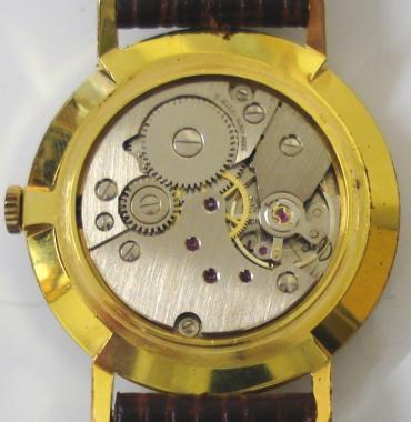 Delvina Geneve manual wind wrist watch in a gold plated case with stainless steel back, on a dark brown leather strap with gilt buckle. Silver brushed dial with gilt baton hour markers and matching gilt hands. Swiss Peseux 17 jewel incabloc calibre 7040 movement.