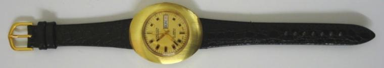 Cadilca Rondamatic automatic wrist watch in a gold plated case with a stainless steel back, on a black leather strap with gilt buckle. Gold coloured dial with gilt and black baton hour markers and matching hands with sweep seconds hand and day / date display at 3 o/c. Swiss made Rondamatic calibre 1239-21 17 jewel automatic incabloc movement with screw on case back.