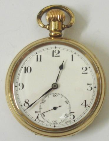 Swiss Revue pocket watch in a Dennison gold plated case with top wind and time change. White enamel dial with black arabic hours and blued steel hands and subsidiary seconds dial at 6 o/c. Swiss manual wind lever movement with 7 jewels, the Dennison watch case back numbered #221208.