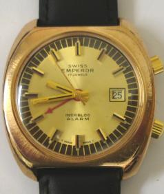 Swiss Emperor manual wind alarm wrist watch gold plated and stainless steel case. Gilt dial, luminous insert hands, sweep seconds. Red alarm hand, date display.