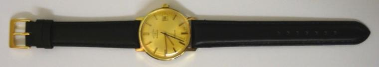 Swiss Rotary automatic wrist watch in a gold plated case with stainless steel back on a black leather strap with gilt buckle. Brushed gilt dial with gold and black baton hour markers and matching hands with black sweep seconds hand and date display at 3 o/c. Swiss 21 jewel incabloc AS 2063 automatic movement.