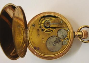 Unsigned English gold plated pocket watch in a Dennison 'Star' case. White enamel dial with black roman hours and blued steel hands with a subsidiary seconds dial. Jewelled lever movement with split bi-metallic balance and overcoil hair spring and stamped 'Made in England' and numbered #829487 with case number #190041.