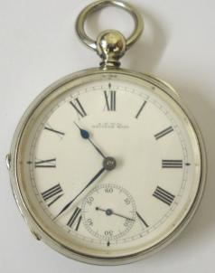 American A.W.W & Co Waltham nickel cased open face pocket watch with key wind and time change. White enamel dial with black roman hours, blued steel hands and subsidiary seconds dial. Signed Waltham jeweled lever safety pinion movement with split bi-metallic balance and numbered #4914409 with case number #679.