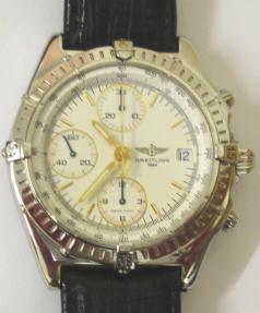 Breitling Automatic Chronograph in a stainless steel case on an original black leather strap. Sapphire crystal over a white dial with gilt and luminous baton hour markers and matching hands with a subsidiary seconds dial and date display at 3 o/c. 12 hour chronograph time recording via the sweep seconds hand and a subsidiary hours and minutes dials. Screw down crown and case back with signed 25 jewel calibre 7750 Valjoux movement complete with all original paperwork and boxes.