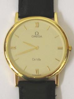 Omega De Ville Summit '92 Quartz wrist watch in an 18ct Gold case with black leather strap and gilt buckle. Champagne dial with gilt Roman quarters and baton hour markers and matching gilt hands. Case back is inscribed Summit '92 with initials and has a serial number #53554477 and is complete with original Omega presentation box.