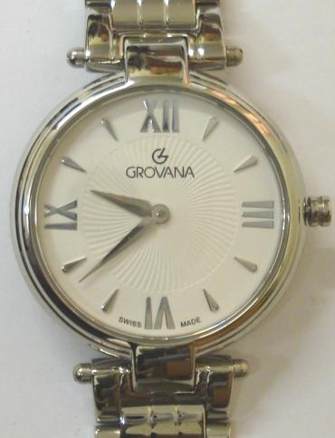 Brand new mid-size quartz wrist watch by Grovana in an all stainless steel case with integral bracelet. Sapphire crystal over a white textured dial with polished silvered hours and matching hands. Brand new model 4576.1LE watch number 1132 water resistant to 30 metres complete with box, all paperwork and manufacturer's guarantee.