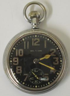 American Waltham Premier 16s WW2 military pocket watch. Black enamel dial with luminous Arabic hours with matching hands and subsidiary seconds dial at 6 o/c. Base metal case with screw on front and back with 9 jewel overcoil hairspring jewelled lever movement dating from c1942, adjusted for temperature and 3 positions and numbered #31271402. The case back is inscribed Keystone 731519 and bears a broad arrow mark numbered 1520.