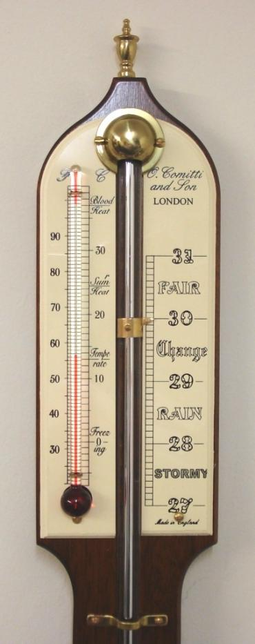 "Modern Comitti of London mercury stick barometer with red alcohol Fahrenheit and Centigrade thermometer in a mahogany case with brass finial and circular bottom mercury reservoir.  Dimensions: - Height 36"", width 3"", depth 1.5""."