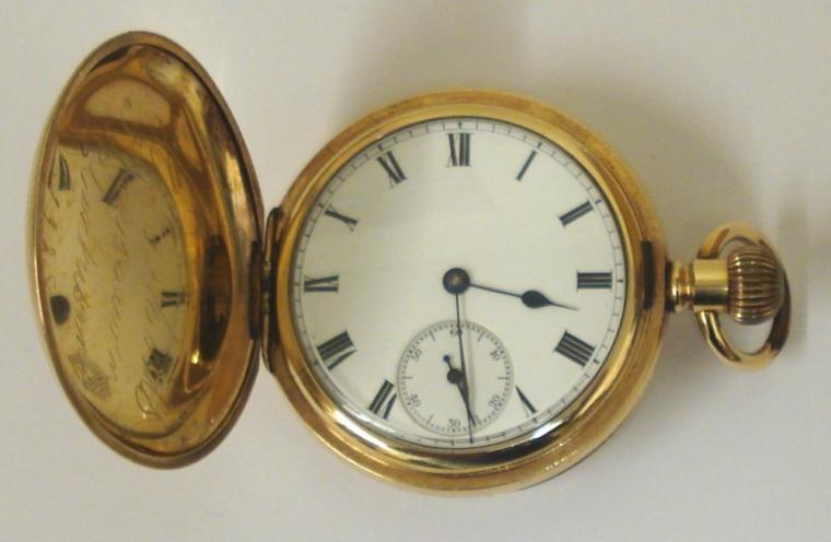 American Waltham Traveler full hunter pocket watch in a gold plated Dennison case with top wind and time change. White enamel dial with black Roman hours, black steel hands and subsidiary seconds dial. Jewelled lever movement with split bi-metallic balance and overcoil hairspring. Dennison case number #72339 and signed movement number #12386783 circa 1903.