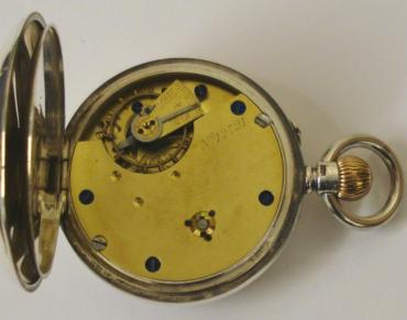 English silver cased open face pocket watch by the Lancashire Watch Company with top wind and rocking bar time change. White enamel dial with black Roman hours, blued steel hands and subsidiary seconds dial. Three quarter plate jewelled lever movement with split bi-metallic balance and overcoil hairspring and numbered #12721 with case numbered #737 and hallmarked for Chester circa 1895.
