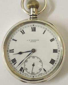 Swiss silver cased pocket watch with London hallmark for 1936 by J.W.Benson. Top wind and time change with white enamel dial and black Roman hours with blued steel hands and a subsidiary seconds dial. Signed 15 jewel lever movement reference 9398, case numbered #655245.