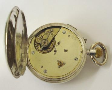 Swiss silver cased pocket watch with London import hallmark for 1919 retailed by John Russell, London. Top wind and rocking bar time change with white enamel dial and black Roman hours with gilt hands and blued sweep seconds hand. Unsigned 3/4 plate jewelled lever movement with chronograph style stop button at 2 o/c, case numbered #59833.
