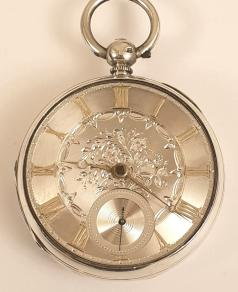 English silver cased key wound fusee pocket watch with London hallmark for circa 1855. Silver engine turned and floral engraved dial with gilt Roman hours and matching Breguet style hands with subsidiary seconds dial at 6 o/c. Decoratively engraved cock piece with diamond end stone and unsigned back plate numbered #9410 with a further three wheels jewelled.