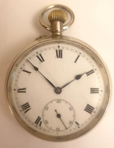 Swiss silver plated pocket watch by Baume and Co. circa1920s. Top wind and rocking bar time change with white enamel dial and black Roman hours with black steel hands and a subsidiary seconds dial at 6 o/c. Signed seven jewel lever movement with bi-metallic balance with case back internally signed and numbered #729028.