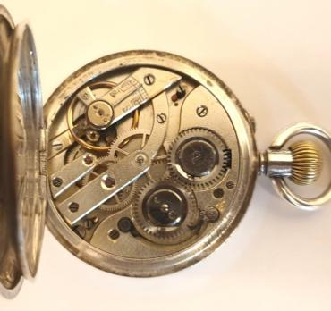 Swiss silver cased pocket watch, maker unknown circa 1910. Top wind and rocking bar time change with white enamel dial and black Roman hours with blued steel hands and subsidiary seconds dial at 6 o/c. Swiss cylinder escapement and split bar movement with case stamped '0.935' and numbered #135423.