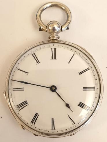 Small Swiss silver cased pocket watch maker unknown late C19th. Key wind and time change with a white enamel dial and black Roman hours with black hands. Unsigned Swiss cylinder split bar movement with case stamped 'Fine Silver' and 'CB' and numbered #28638.
