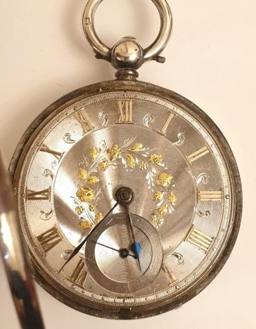 English silver cased fusee pocket watch by Cattaneo of Stockton. Key wind and time change with silver dial with engine turning and applied gold floral decoration. Gilt Roman hours with blued steel hands and subsidiary seconds dial, the silver case hallmarked for London circa 1856. Signed fusee movement with floral decorated cock piece and diamond end stone and numbered #1180 with a secondary numbering of #6992. This number is repeated with the case hallmarks which also bear a personal ownership wriggle-work inscription dated 1897.