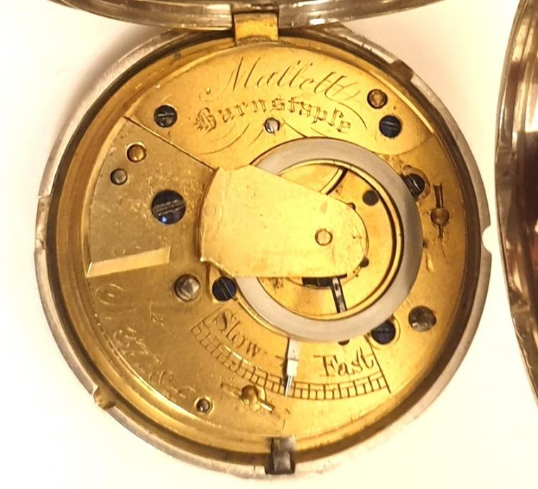 English silver cased key wind and time change fusee verge full hunter pocket watch by Mallett of Barnstaple, hallmarked throughout for London c1856. White enamel dial with black Roman hours and gilt hands. Signed and engraved back plate with plain cock piece and numbered #37184, the numbering repeated on the casework which also bears the initials 'ED'.