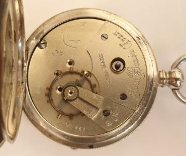 Swiss silver cased cylinder pocket watch late C19th made for the New Haven Watch Co. Connecticut. Key wind and time change with signed white enamel dial and black Roman hours with blued steel hands and subsidiary seconds dial. The silver case stamped 0.800 together with a Swiss 1882-1934 proof mark and numbered #2027. Swiss jewelled cut bi-metallic balance movement with cylinder escapement and back plate signed and numbered #1264441 and bearing a raised arm holding a scimitar touch mark.