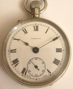 Swiss early c20th nickel cased pocket watch with top wind and rocking bar time change. White enamel dial signed Vibrona, with black Roman hours and blued steel hands with subsidiary seconds dial at 6 o/c. Plain pin lever movement with a jewelled balance and machine decorated back plate.