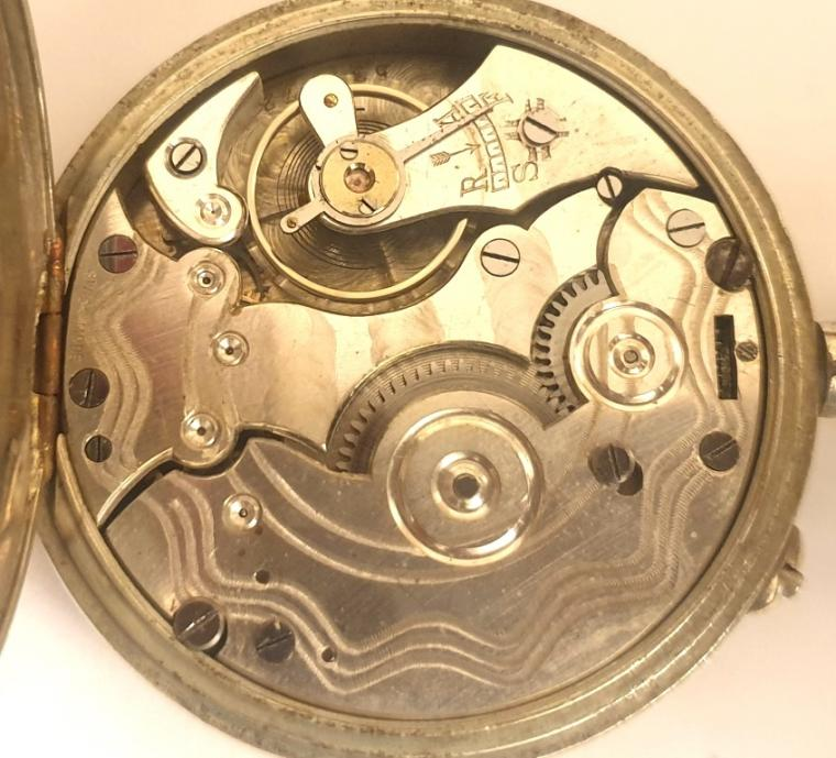SSwiss early c20th nickel cased pocket watch with top wind and rocking bar time change. White enamel dial signed Vibrona, with black Roman hours and blued steel hands with subsidiary seconds dial at 6 o/c. Plain pin lever movement with a jewelled balance and machine decorated back plate.