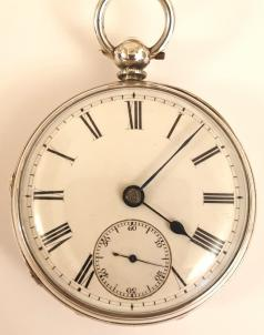 English silver cased fusee pocket watch, maker unknown. Key wind and time change with white enamel dial with black Roman hours and blued steel hands with a subsidiary seconds dial at 6 o/c, the silver case hallmarked for London circa 1864. Unsigned fusee movement with plain cock piece and a diamond end-stone with a split bi-metallic balance wheel. The silver case and cock piece are both numbered #11512.