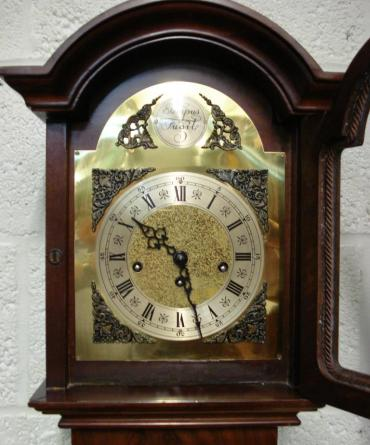 "Modern 8 day Westminster Chime Longcase clock with burr walnut veneer and inlaid case. 8 day spring driven movement housed  in attractive casework with dimensions - Height 66"", Width 12"", Depth 8""."