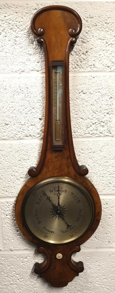 C19th mahogany cased mercury wheel barometer with decorative edge moulding. Circular gilt brass bezel with flat glass over a silvered dial with black inches of mercury pressure index and blued steel pressure indicating hand with a brass history marker which is manually adjusted by the lower ivory coloured wheel. Complete with a separate silvered dial Fahrenheit thermometer.  Dimensions: - Height 1200mm, width 330mm.