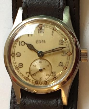 Swiss ex-military Ebel manual wind wrist watch c1940 in a stainless steel case with black leather strap. Light coloured dial with aged black Arabic hours with luminous markers and blued luminous insert steel hands with a subsidiary seconds dial at 6 o/c. Signed Ebel calibre 99 jewelled lever movement with case back numbered 999901.