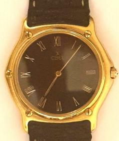 Gents Swiss made Ebel quartz wrist watch in an 18K gold case with leather strap and 18K gold deployment buckle. Black dial with polished gilt hands and matching Roman hour markers.
