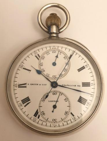 Swiss silver cased chronograph pocket watch retailed by S.Smith and Sons of London with a London import hallmark for 1918 and numbered 176136. Top wind and time change with single push chronograph activation button. White enamel dial and black Roman hours with blued steel hands and subsidiary seconds dial at 6 o/c. Sixty minute chronograph recording via the centre seconds hand and the minutes dial at 12 o/c. Swiss jewelled lever movement signed Contetout and numbered 352 - 71222, with overcoil hairspring and split bi-metallic balance and pillar wheel control system for the chronograph function.