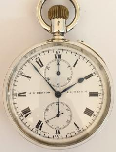 J.W.Benson silver cased chronograph pocket with Longines movement and a London import hallmark for 1910 and numbered 2224673. Top wind and rocking bar time change with single push chronograph activation button. White enamel dial and black Roman hours with blued steel hands and subsidiary seconds dial at 6 o/c. Thirty minute chronograph recording via the centre seconds hand and the minutes dial at 12 o/c. Swiss Longines calibre 19.73 jewelled lever movement with overcoil hairspring and split bi-metallic balance. Pillar wheel control system for the chronograph function with instantaneous minute recorder.
