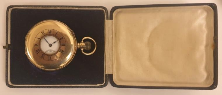 Swiss half hunter pocket watch in a 9ct gold Dennison case hallmarked for Birmingham c1921 with top wind and time change. External black Roman chapter ring on the case outer, internal white enamel dial with black Roman hours and blued steel hands and a subsidiary seconds dial at 6 o/c. Swiss jewelled lever movement with overcoil hairspring and split bi-metallic balance jewelled to the centre, with gold case numbered 223851 and complete with plush lined retail case.