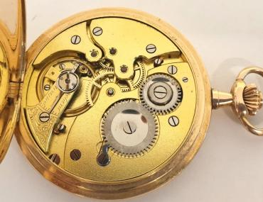 Swiss full hunter pocket watch in a 14ct gold case signed Haefliger Freres, Lucerne and c1900, with top wind and rocking bar time change. Outer case with monogram over a gilt dial with engine turned centre, black Arabic hours, blued steel hands and subsidiary seconds dial at 6 o/c. Jewelled lever movement with bi-metallic balance, gold case with 'ACD' maker's mark and numbered 112326.