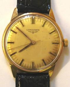 Gents 9ct gold Longines 6942 manual wind wrist watch c1973, mounted on a French Black Crocodile strap. Gold coloured dial with gold and black insert hands and hour markers and sweep second hand. 17 jewel unadjusted movement numbered 52019768 housed in a 9ct gold Baume case numbered #78614.