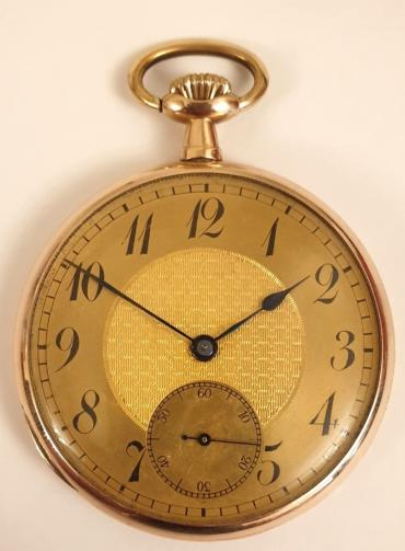 9K gold cased dress pocket watch circa 1920, unsigned. Top wind and time change with champagne coloured dial with engine turned centre, black Arabic hours and blued steel hands with subsidiary seconds dial at 6 o/c. Unsigned continental gold case numbered 150000 with inner metal dust cover and 15 jewel jewelled lever movement.
