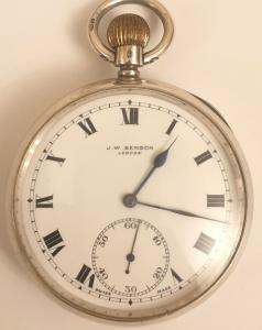 Swiss J.W.Benson silver cased pocket watch with London import hallmark for 1919. Top wind and time change with signed white enamel dial with black Roman hours and blued steel hands with subsidiary seconds dial at 6 o/c. Signed 17 jewel jewelled lever movement with split bi-metallic balance with micro regulator and inscribed 'By Warrant To HM The Late Queen Victoria' in a silver case numbered 2076555.
