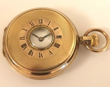 Swiss unsigned half hunter pocket watch c1900 in a gold filled, coin edging case with top wind and time change. External black Roman chapter ring on the outer case, internal white enamel dial with black Roman hours and blued steel hands with a subsidiary seconds dial at 6 o/c. Standard Swiss unsigned 15 jewel jewelled lever movement.