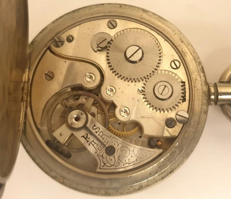 Swiss WWI 30 minute recording unsigned pocket stop watch in a nickel case. Hand wind and start, stop and return to zero functions via push in crown. White enamelled dial with black Arabic outer 60 seconds register with 30 minute time recording subsidiary dial. Swiss unsigned jewelled lever escapement.